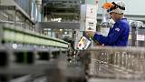 Japan manufacturers' outlook less negative, service sector up - Reuters Tankan