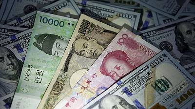 Currencies whipsaw on mixed trade signals, yuan rebounds