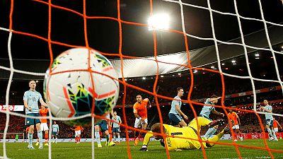 Dutch grab late goals to beat Northern Ireland