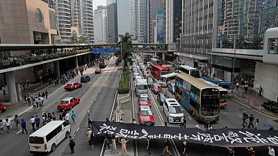 Hundreds take to Hong Kong streets ahead of weekend protests