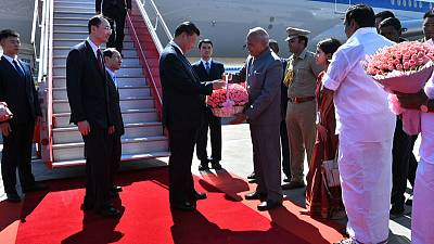 China's Xi lands in India amid scattered Tibetan protests