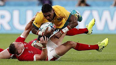 Australia outlast Georgia to stumble into the knockout stages