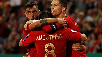 Portugal and Ukraine close in on Euro 2020 with home wins