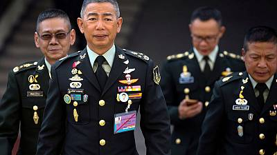 Thai army chief decries opposition, hints at threat to monarchy