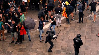 Spain jails Catalan separatist leaders, sparking protests, clashes