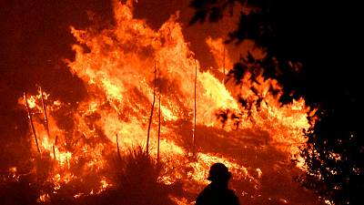 Deadly Los Angeles wildfire burns with subdued fury after change in weather