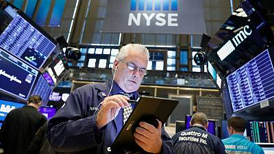 Stocks meander on caution over trade talks, dollar gains