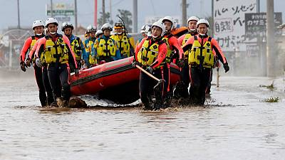 Japan rescuers wade in muddy waters to find typhoon survivors