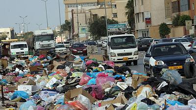 Libyan conflict leaves rubbish mounds smouldering in Tripoli's streets