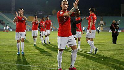 England thrash Bulgaria after game is halted over racist abuse