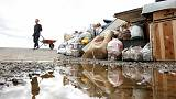 Rescuers slog through mud as Japan typhoon death toll rises to 66