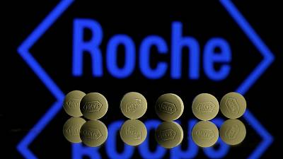 Roche boosts 2019 sales outlook, sees Spark deal this year