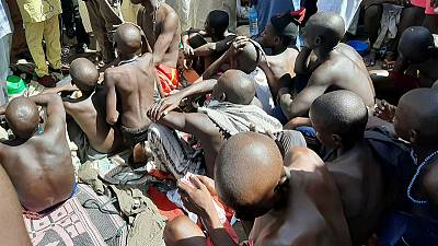 Police free hundreds of males, some chained and beaten, from Nigerian school in third raid this month