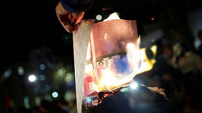 Ballot boxes burn in Bolivia as contested vote count ignites protests