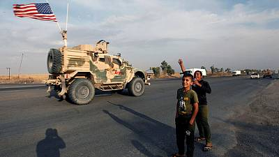 U.S. forces withdrawing from Syria into Iraq have no approval to stay - Iraqi military