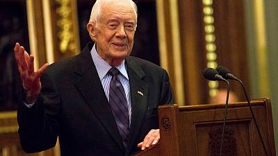 Former U.S. President Carter hospitalized with broken pelvis after fall