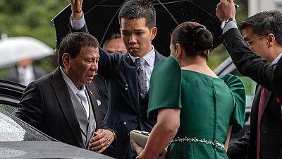 'Unbearable pain' cuts short Philippine leader's Japan trip