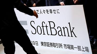 SoftBank shares fall as it doubles down on WeWork