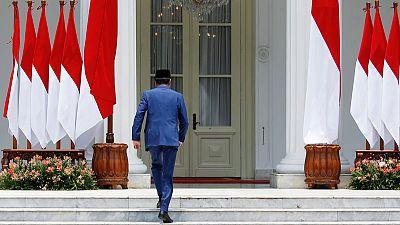 Widodo's gamble: Indonesia president includes fierce rival in cabinet