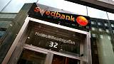 Swedbank third-quarter profit squeezed by costs for money-laundering fall-out