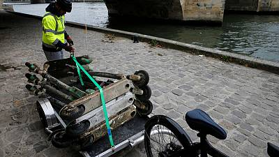 Fishing for scooters in the shadow of the Eiffel Tower