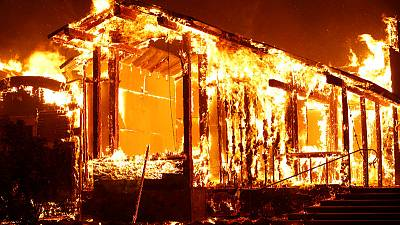 Firefighters struggle against massive, wind-whipped California wildfire