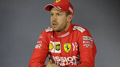 Vettel takes issue with 'selfie guy' and sponsored trophy