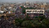 Iraqi protesters pack Baghdad square, anti-government movement gains momentum