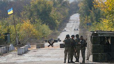 Ukraine starts withdrawal of troops in rebel east