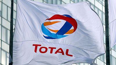 Record third-quarter output boosts Total's cash flow, low prices hit profit