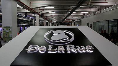 De La Rue warns on profit again as new chief reviews business