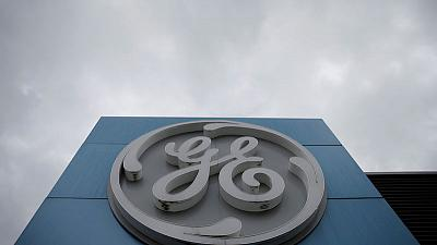 GE posts another loss, raises cash flow forecast