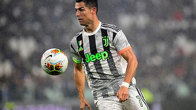 Ronaldo's stoppage time penalty sinks 10-man Genoa