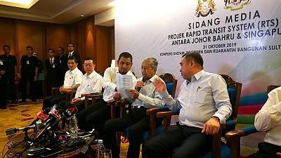 Malaysia-Singapore rail link back on at lower cost - Mahathir