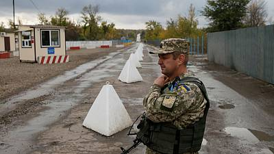 Ukraine plans more troop withdrawals in east ahead of peace talks