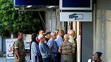 Queues but no panic as Lebanese banks re-open after two-week hiatus