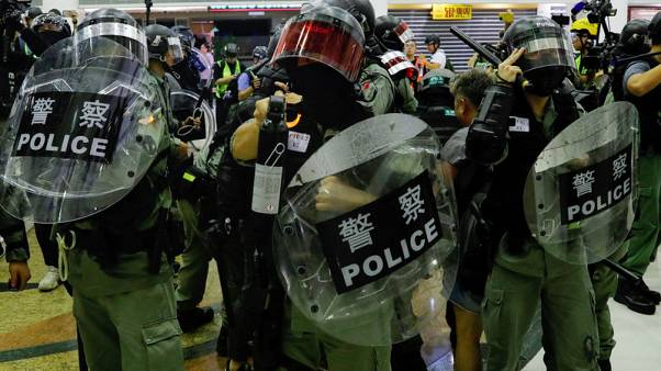 Chinese state media urge 'tougher line' in Hong Kong after Xinhua targeted