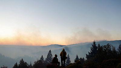 California winds slacken, helping firefighters control blazes
