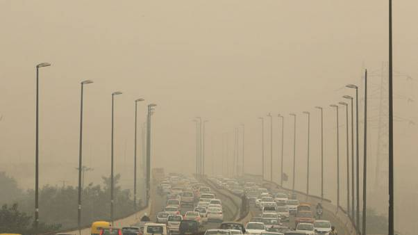 Indian capital banishes some cars in bid to curb hazardous air pollution