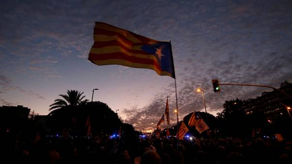 Spanish king greeted with protests in Catalonia