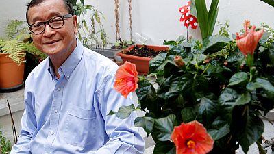 Facing arrest, Cambodia's Sam Rainsy vows he will return Saturday