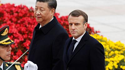 China and France sign deals worth $15 billion during Macron's visit