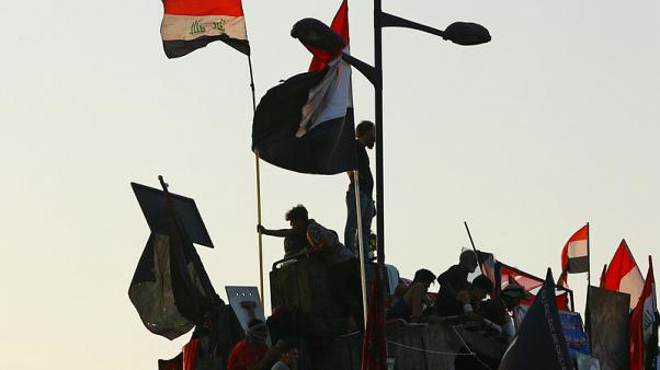 Iraqi security forces break up protests in Battle of the Bridges