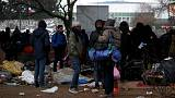 France says to clear some migrant camps by year-end