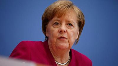 """German coalition parties vow to stay together but have """"a lot to do"""""""