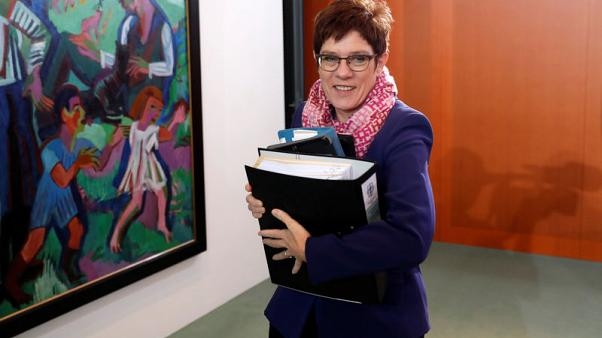 Germany's Kramp-Karrenbauer wants Merkel to stay until 2021