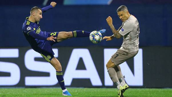 Shakhtar score twice in stoppage time in 3-3 draw at Zagreb
