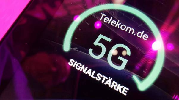 Deutsche Telekom cuts dividend as it hikes profit outlook
