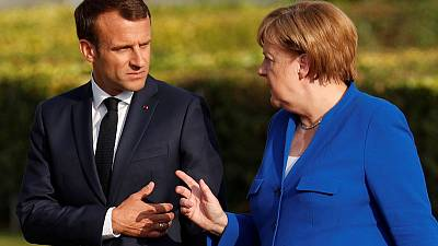 Merkel, NATO chief reject Macron's view NATO is dying