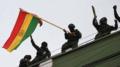 Bolivian police seen joining scattered anti-Morales protests